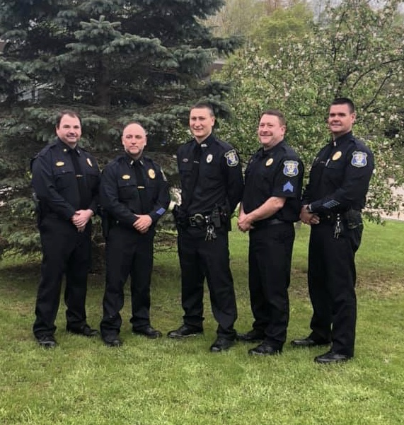 Chief Andrew Kennedy, Lieutenant Dan Mousaw, Patrolman Andrew Layng, Retired Detective Sergeant David Layng and Lieutenant Robert Wescott